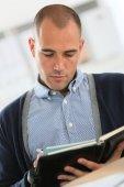 Businessman at work checking on agenda — Stock Photo