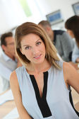 Woman attending business meeting — Stock Photo