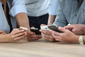 Smarphones being used in office — Stock Photo