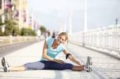 Jogger stretching after exercising in street — Stock Photo
