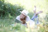 Woman using digital tablet in field — Stock Photo