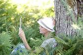 Woman reading novel on tablet — Stock Photo