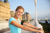 Woman stretching out after running — Stock Photo