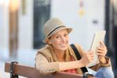 Trendy girl using tablet in town — Stock Photo