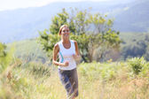 Woman running in countryside — Stock Photo
