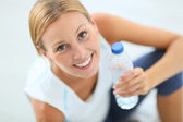 Girl drinking water after exercising — Photo