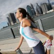 Woman stretching out on Brooklyn Heights promenade — Stock Photo #58084633