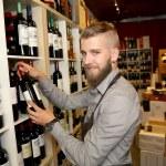 Man working in wine shop — Stock Photo #58084733