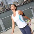 Woman stretching out on Brooklyn Heights promenade — Stock Photo #58085585