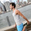 Man stretching out on Brooklyn Heights promenade — Stock Photo #58085649