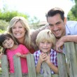 Family leaning on fence — Stock Photo #58085777