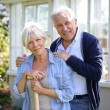 Couple standing by greenhouse in garden — Stock Photo #58086337