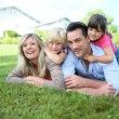 Family laying on grass — Stock Photo #58086973