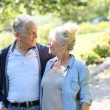 Senior couple walking together in park — Stock Photo #58087429