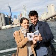 Tourists reading New York city guide — Stock Photo #58087453