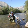Fisherman catching fario trout in river — Stock Photo #58088113