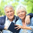 Senior couple relaxing in garden — Stock Photo #58088487