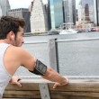 Man stretching out on Brooklyn Heights promenade — Stock Photo #58088607