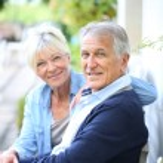 Senior couple relaxing on bench — Stock Photo #58089025