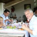 Family having summmer lunch — Stock Photo #58089055