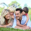 Family laying on grass — Stock Photo #58089131