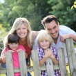 Family leaning on fence — Stock Photo #58089263