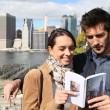 Tourists reading New York city guide — Stock Photo #58089347