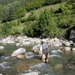 Fisherman fishing in river — Stock Photo #58089809