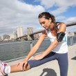 Woman stretching out on Brooklyn Heights promenade — Stock Photo #58089985