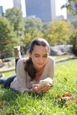Woman in Central Park using smartphone — Stock Photo