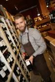 Man working in wine shop — Stock Photo