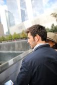 Tourists visiting 911 memorial in Manhattan — Stock Photo