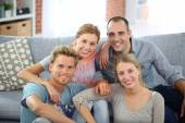 Roommates sitting together in couch — Stock Photo