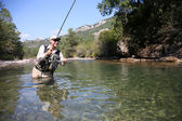 Fisherman fishing in freshwater river — Stock Photo