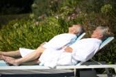 Couple enjoying in spa hotel pool — Stock Photo