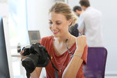 Woman photographer working in office — Stock Photo