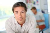 Man working in communication agency — Stock Photo