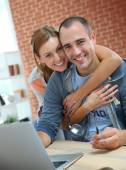 Couple websurfing on internet with laptop — Stock Photo