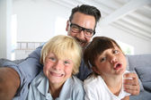 Dad with kids taking picture — Stock Photo