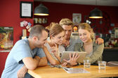 Students in campus lounge websurfing — Stock Photo
