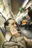 Businesswoman in subway using smartphone — Stock Photo