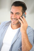 Mature man talking on mobile phone — Stock Photo
