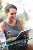 Businesswoman working with tablet — Stock Photo