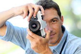 Photographer shooting with old camera — Stock Photo