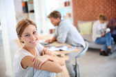 Woman sitting in shared apartment — Stock Photo