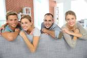 Cheerful roommates sitting in sofa — Foto de Stock