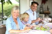 Family having summmer lunch — Stock Photo