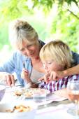 Grandmother with kid having lunch — Stock Photo