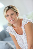 Beautiful 40-year old woman at home — Stock Photo