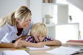 Mom helping boy to do homework — Stock Photo